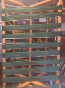 Rows of green 10/2 warp for holiday towels