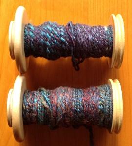 First two bobbins of plied yarn.