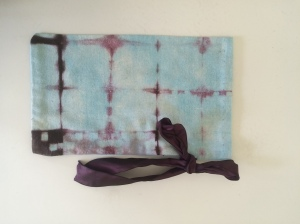More raw silk gift bags.  In this case dyed with acid fast blue then overdyed purple with shibori technique.