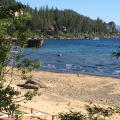 Drought stricken Lake Tahoe with beach that should be completely under water.